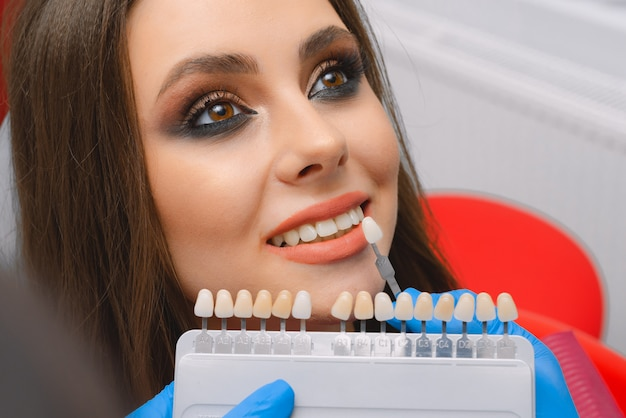 Young patient selects tooth color