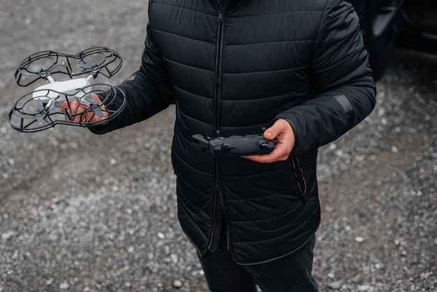 Young people are preparing a drone for flight. drone setup.