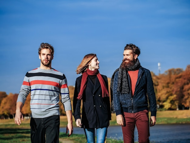Young people in autumn park