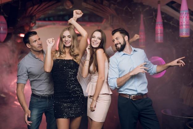 Young people dancing in karaoke club