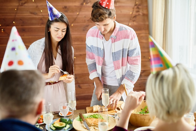 Young people eating at birthday party