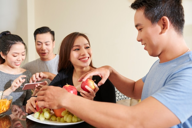 Young people eating fruits at party