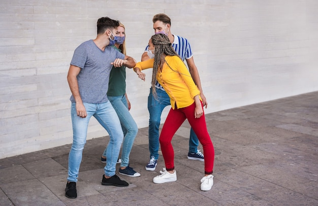 Young people friends bump their elbows