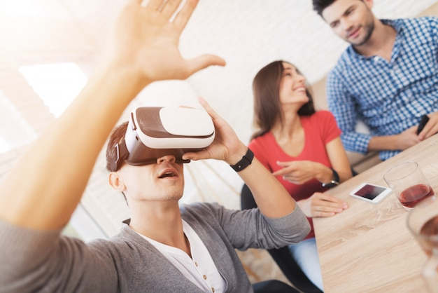 Young people have fun in the helmet of virtual reality.
