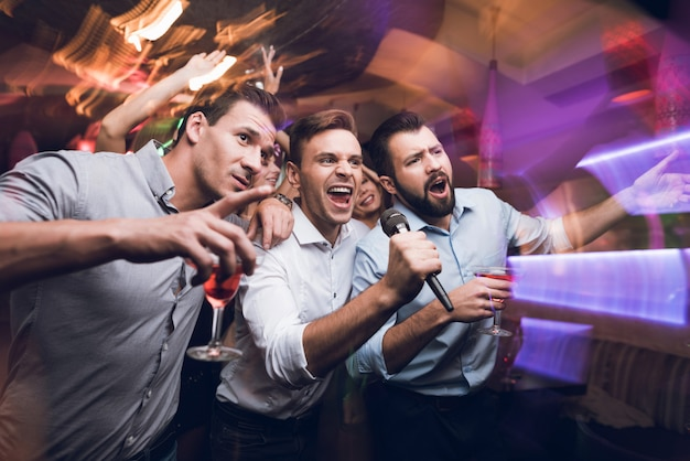 Young people have fun in a nightclub.
