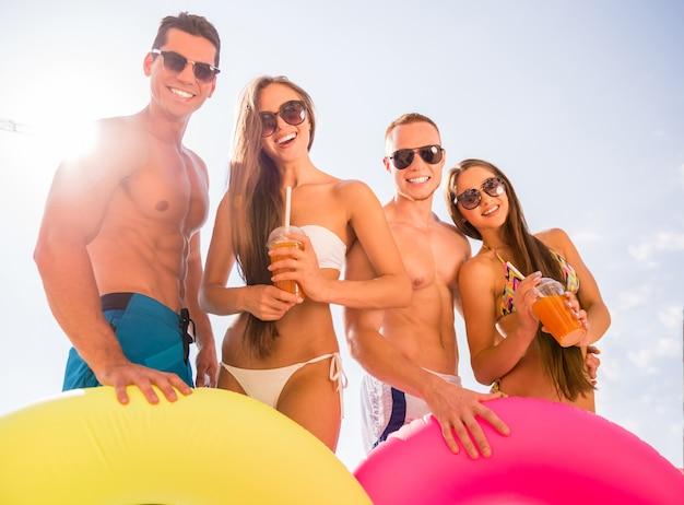 Young people having fun in swimming pool.