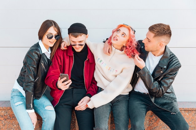 Young people having fun while taking selfie on smartphone