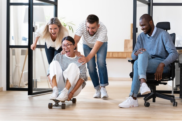 Young people having fun in work break