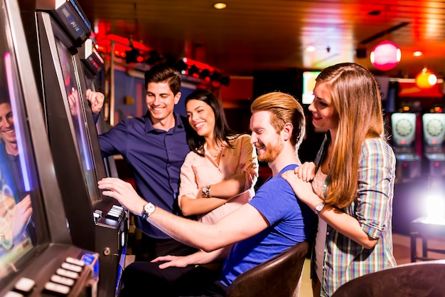 Young people play jackpot in the casino