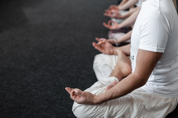 Young people professional is sitting in lotus position. yoga classes. relax time. close-up