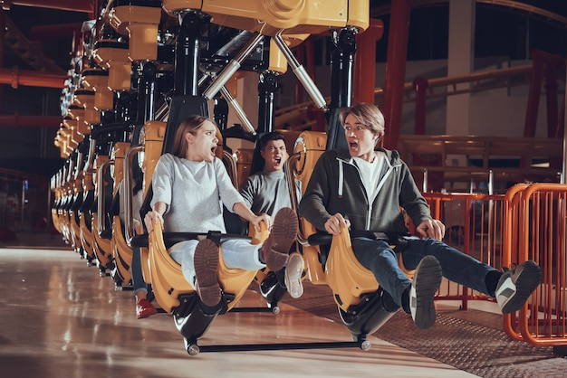Young people in shock from the carousel.