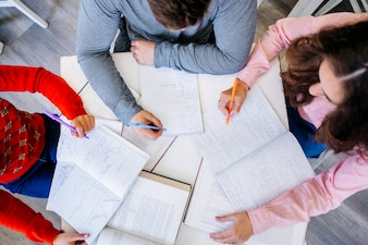 Young people studying together at desktop