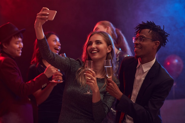Young people taking selfie in nightclub