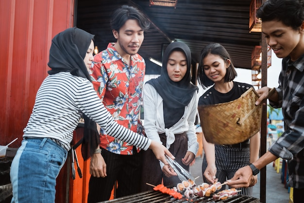 Young people together celebrate the outdoor party