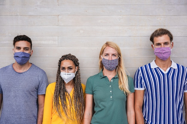 Young people wearing face protective masks for coronavirus prevention
