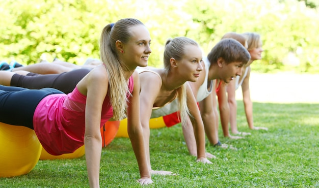 Young people working out in a park