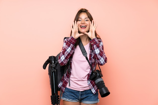 Young photographer girl shouting with mouth wide open