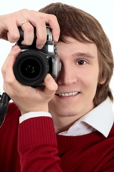 Young photographer man on white background