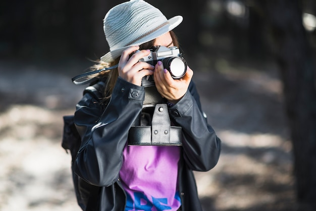 Young photographer taking pictures of nature