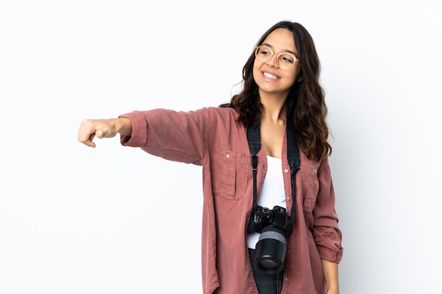 Young photographer woman over isolated white giving a thumbs up gesture