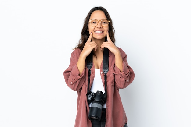Young photographer woman over isolated white smiling with a happy and pleasant expression