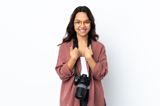 Young photographer woman over isolated white wall with surprise facial expression
