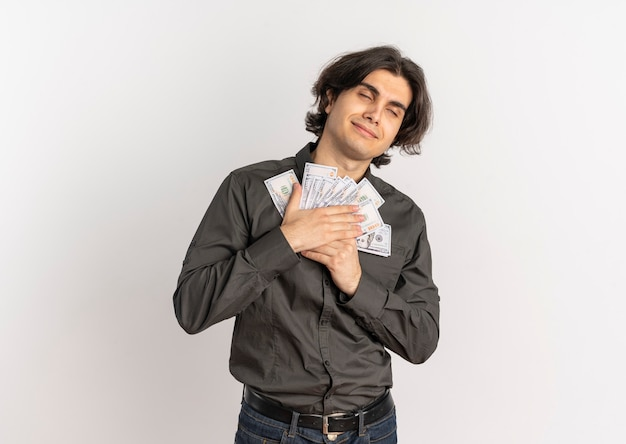 Young pleased handsome caucasian man holds money with both hands isolated on white background with copy space