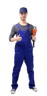 Young plumber holding pipe wrench isolated on white