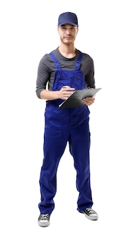 Young plumber in uniform holding clipboard on white background