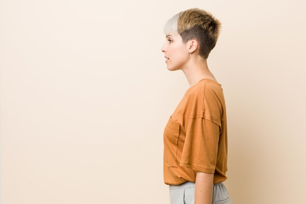 Young plus size woman with short hair gazing left, sideways pose.