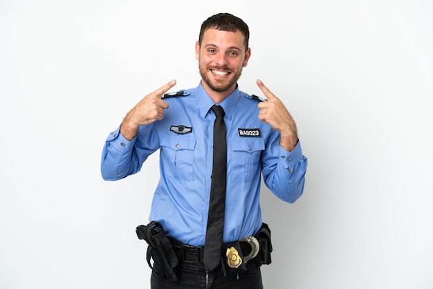 親指を立てるジェスチャーを与える白い背景で隔離の若い警察ブラジル人