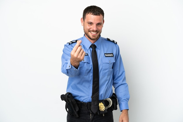 Молодой полицейский бразильский мужчина, изолированные на белом фоне, делая денежный жест Premium Фотографии