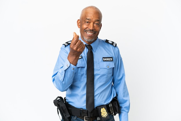 Молодой полицейский, изолированные на белом фоне, делая денежный жест