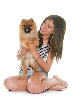 Young pomeranian dog and teen