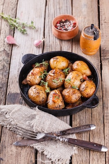 Young potatoes fried in a pan. with garlic, pancetta