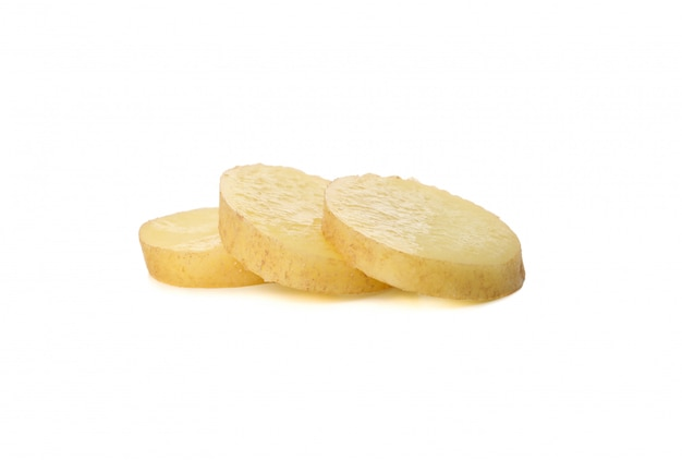 Young potatoes slices isolated on white surface