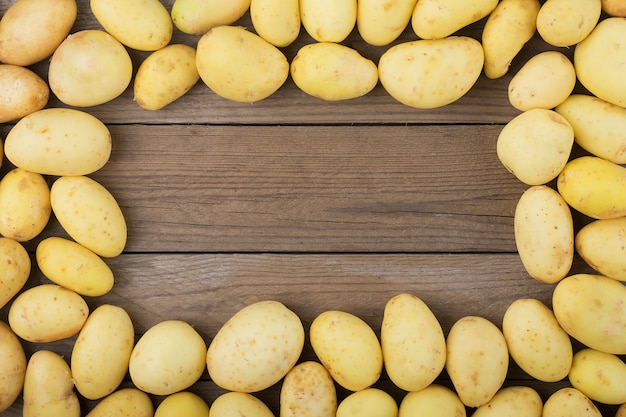 Young potatoes  on wooden table. rustic style. top view. flat lay.
