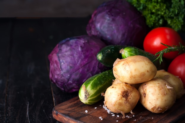 Young potatoes on wooden table