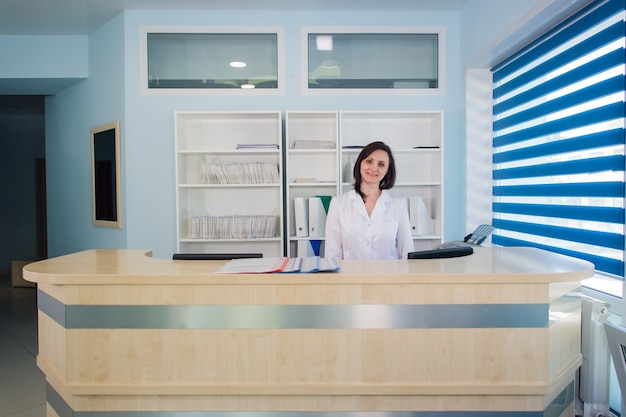 Young practitioner doctor working at the clinic reception desk