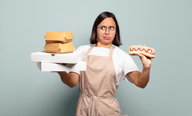 Молодая женщина до шеф-повара. концепция быстрого питания
