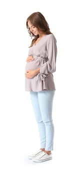 白い表面の若い妊婦