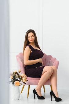 Young pregnant woman posing