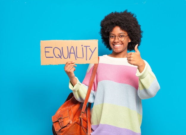 Young pretty afro woman equality concept