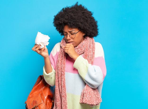 若いかなりアフロ女性インフルエンザまたは病気の概念
