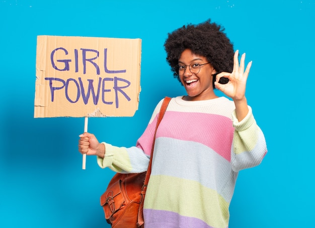 Young pretty afro woman girl power concept