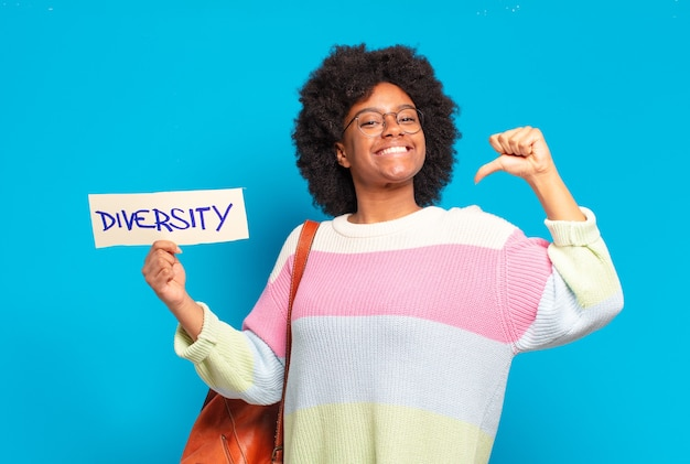 Young pretty afro woman holding diversity concept banner