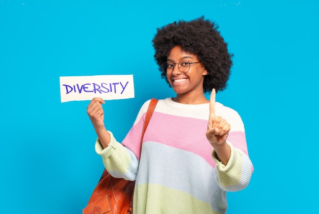 Young pretty afro woman holding diversity concept