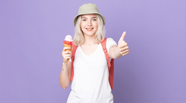 Young pretty albino woman feeling proud,smiling positively with thumbs up .summer concept