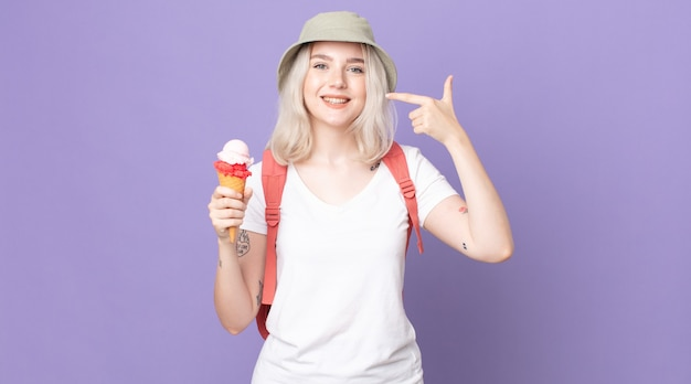 Young pretty albino woman smiling confidently pointing to own broad smile .summer concept