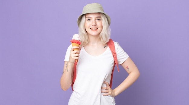 Young pretty albino woman smiling happily with a hand on hip and confident .summer concept